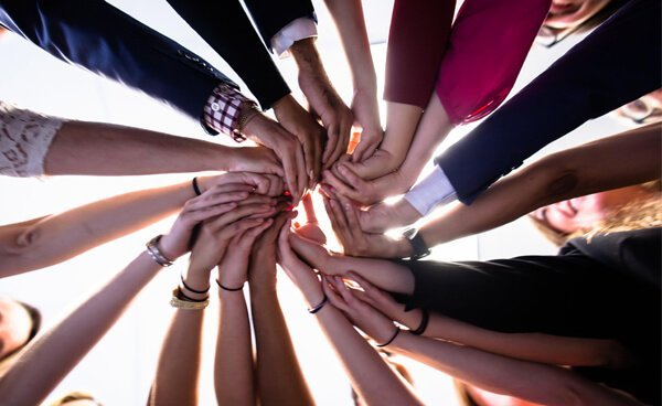 whin-staff-hands-circle